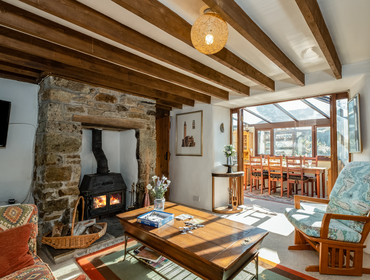 The light filled living room with wood burner at Trehaverock Cottage self catering holiday home in Polzeath.