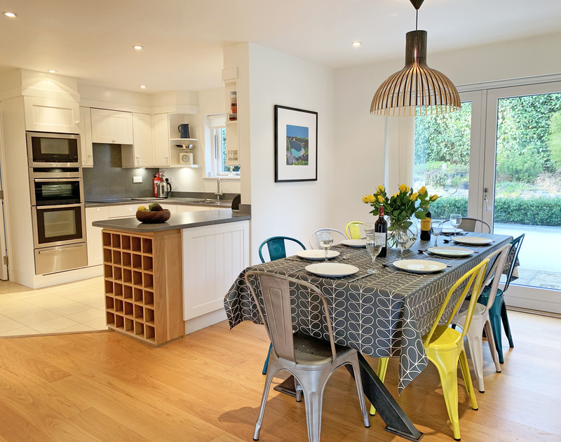 The kitchen and dining area at Out Of The Wind holiday home in Rock, Cornwall.