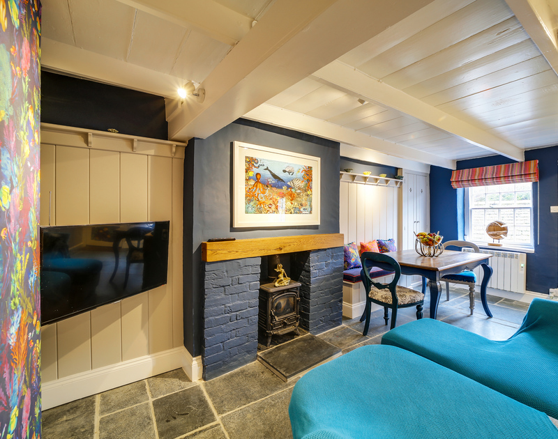 The cosy lounge with TV and fire place in Hillside Cottage self catering holiday home in Port Isaac, North Cornwall.