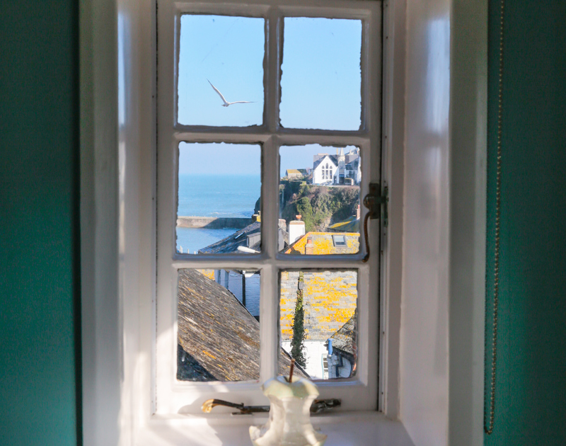 The harbour view from the master bedroom at Hillside Cottage self catering holiday home in Port Isaac, North Cornwall.