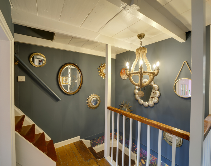 The well lit stairs and landing at Hillside Cottage holiday home in Port Isaac on the North Cornwall coast.