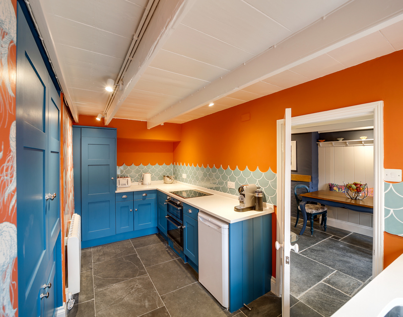 The well-equipped kitchen at Hillside Cottage self catering holiday home in Port Isaac, North Cornwall.