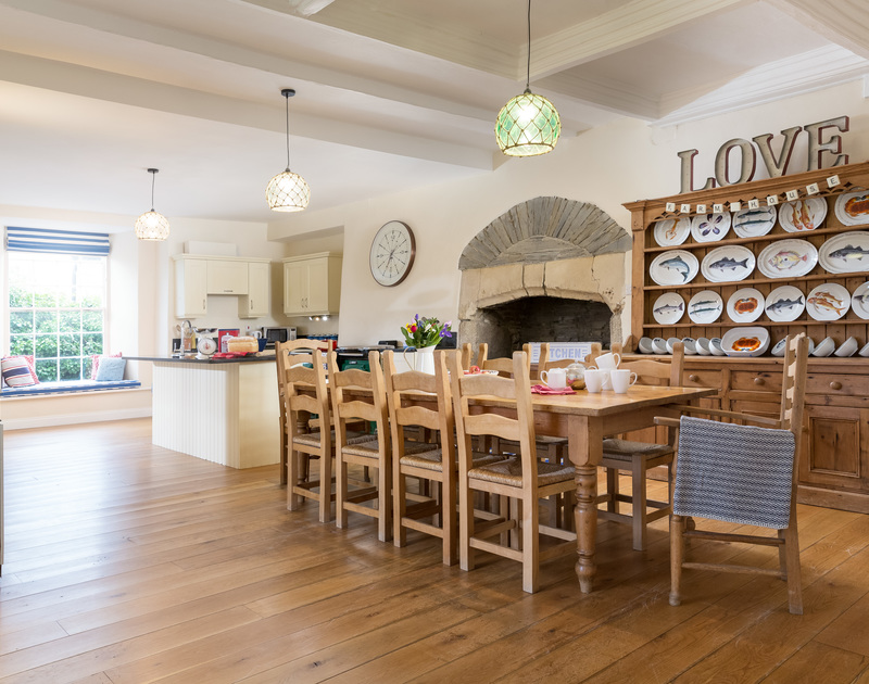 The lovely open plan kitchen, dining and living room at The Farmhouse holiday home in St Minver, Rock.