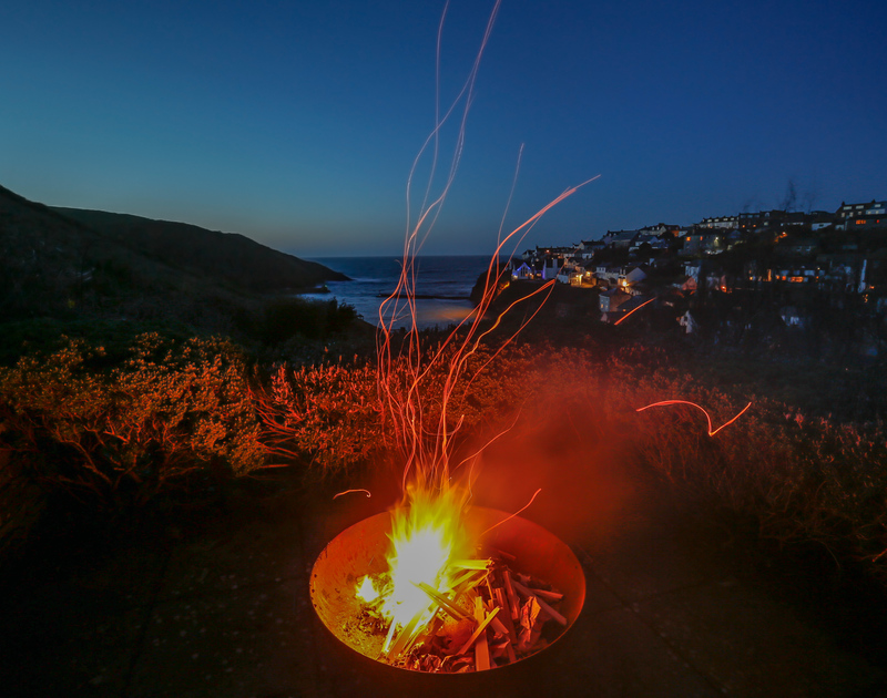 The fire pit in the elevated garden at Hillside Cottage self catering holiday home, perfect for evenings overlooking Port Isaac harbour in North Cornwall.