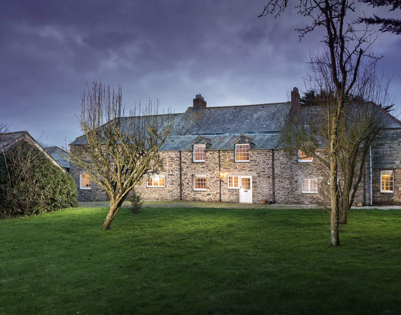 The external view of The Farmhouse holiday home at night, St Minver Rock.