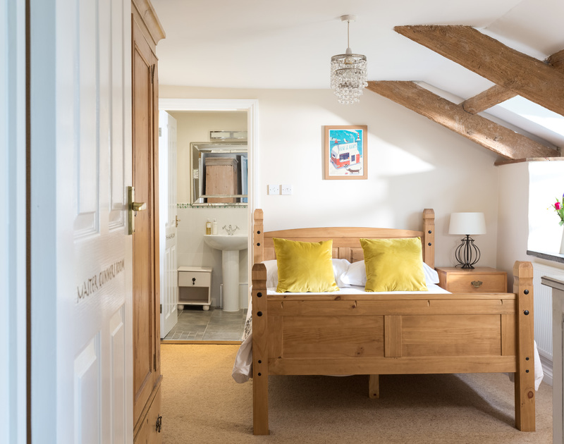 The double bedroom with ensuite bathroom at The Farmhouse self catering holiday home in St Minver, Rock.