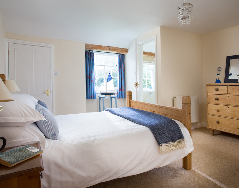 The double bedroom with shower room ensuite at The Farmhouse holiday home in St Minver, Rock.