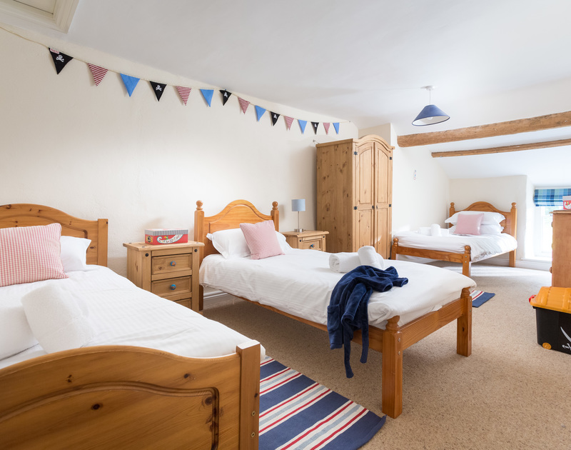 The triple bedroom with single beds at The Farmhouse self catering holiday home in St Minver, Rock.