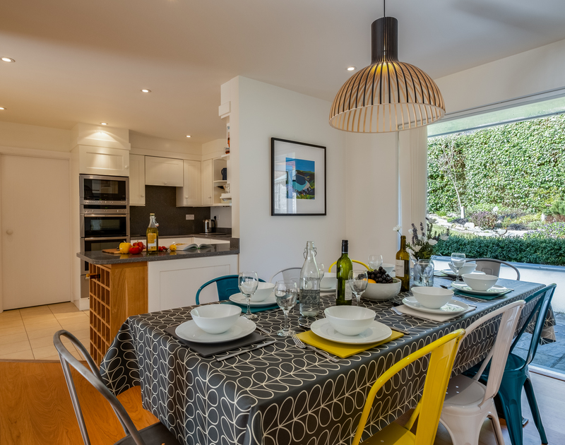 The open plan kitchen, living, dining area at Out Of The Wind self catering holiday home in Rock, North Cornwall.