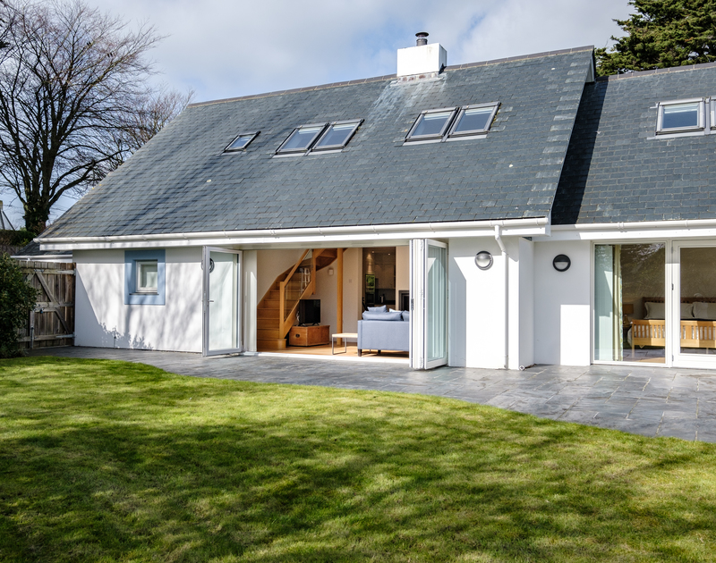 The external view of Out Of The Water self catering holiday home in garden and patio doors.