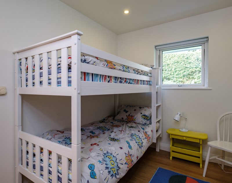 The bunk bedroom at Out Of The Wind self catering holiday home in Rock, North Cornwall.