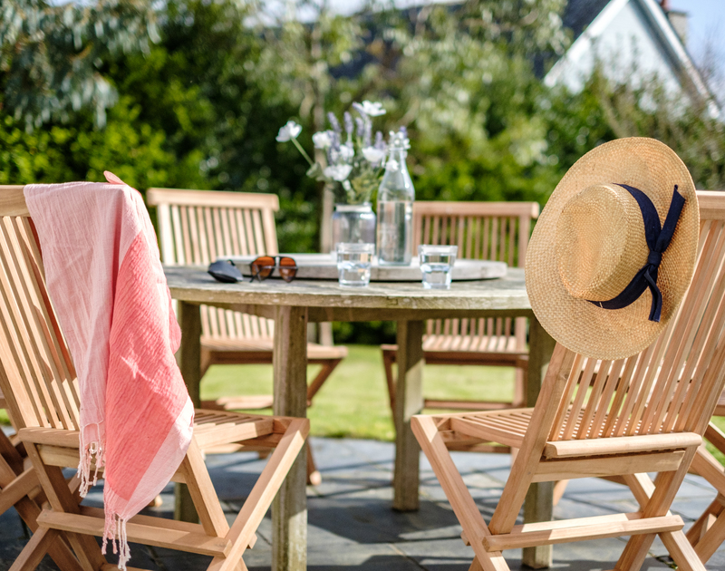 The outdoor seating is perfect for enjoying the sun at Out Of The Wind self catering holiday home in Rock, North Cornwall.