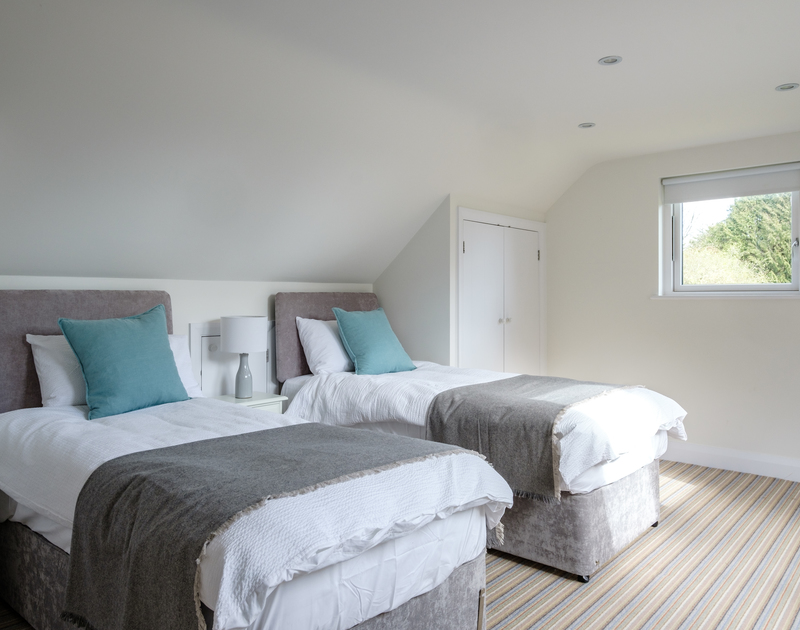 The twin bedroom with ensuite at Out Of The Wind holiday home in Rock, North Cornwall.