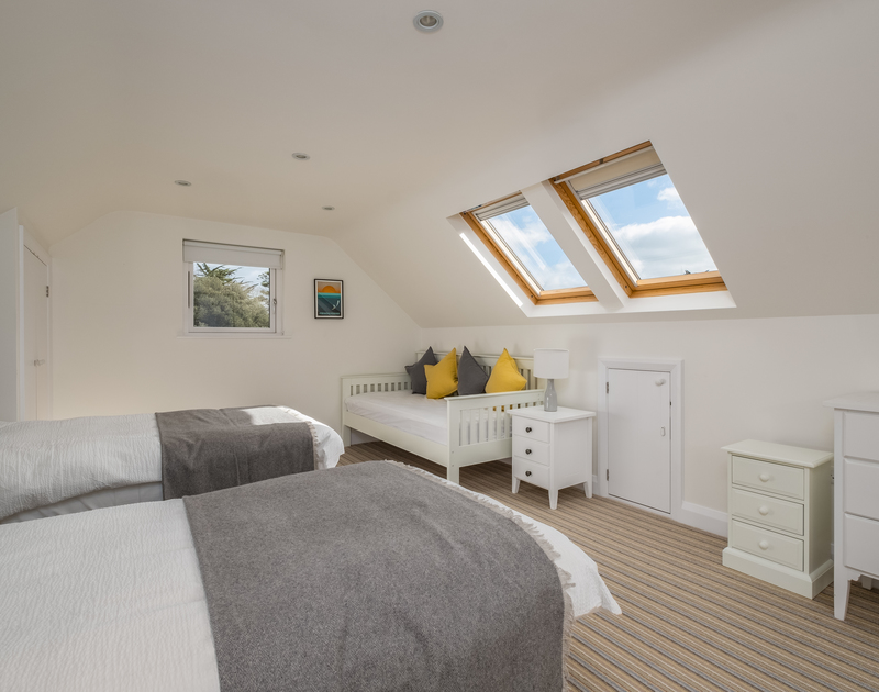 The twin bedroom with ensuite at Out Of The Wind self catering holiday home in Rock, North Cornwall.