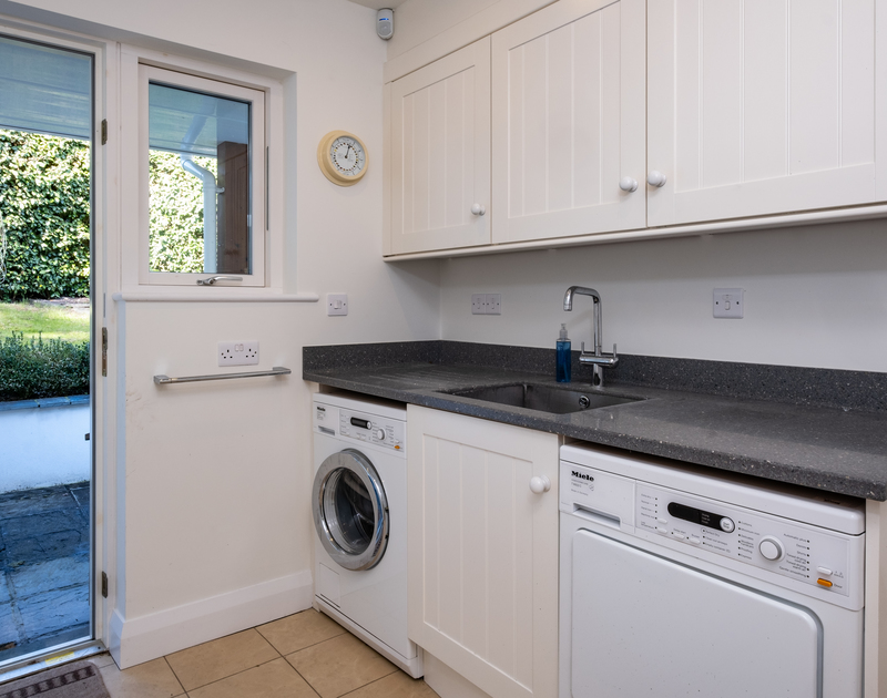 The well-equipped utility room at Out Of The Wind holiday home in Rock, North Cornwall.