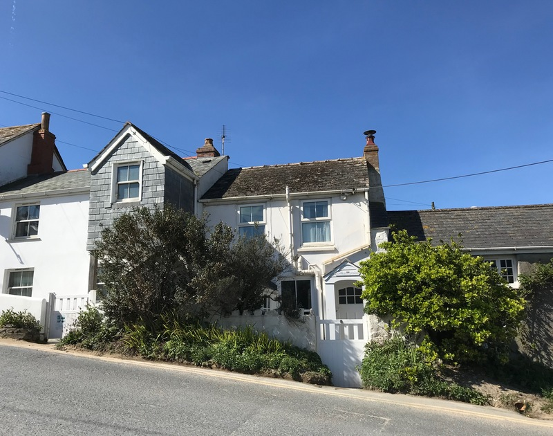 Coppingers is a pretty self-catering cottage just steps from Polzeath beach in Cornwall, available to rent through John Bray Cornish Holidays