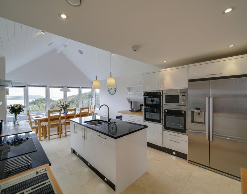 A Sonos music system throughout the house and a state of the art kitchen will make cooking family meals a joy at Clouds Hill in New Polzeath.