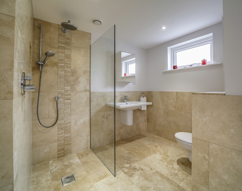 The stylish shower room ensuite for the second double bedroom on the ground floor at Clouds Hill, a luxury self catering holiday house to rent in New Polzeath.