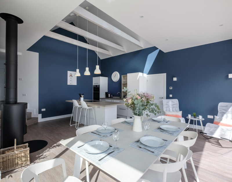 The modern and light open plan kitchen and dining area at Lowena self catering holiday home in Polzeath, North Cornwall.