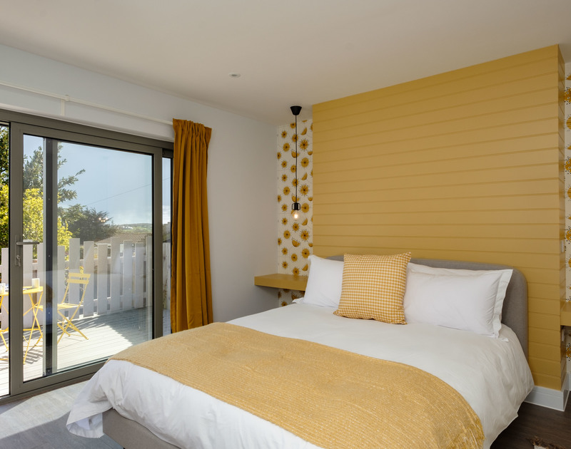 The master bedroom with doors onto the balcony at Lowena self catering holiday home in Polzeath, North Cornwall.