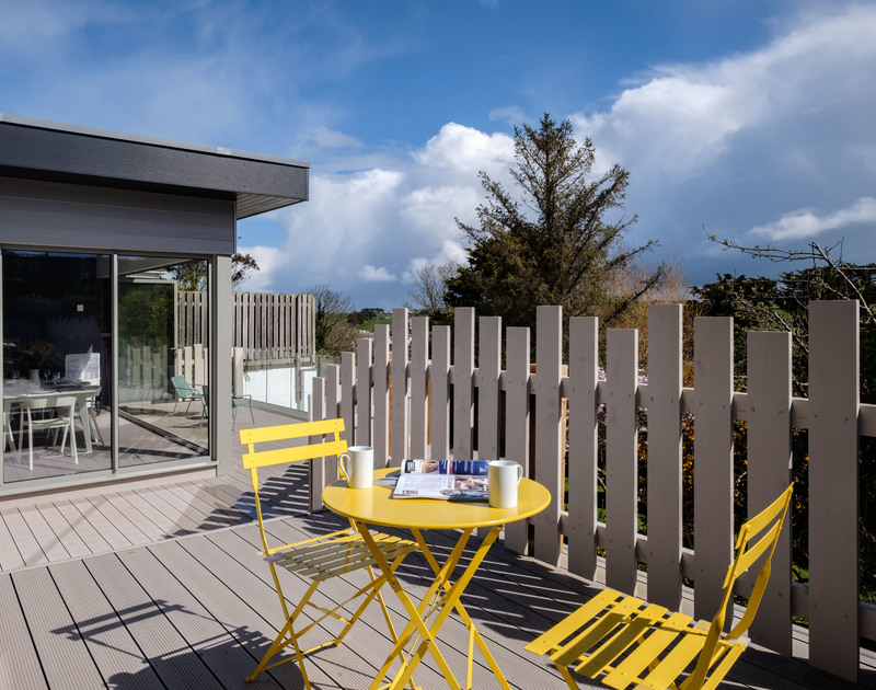The outdoor seating area outside the master bedroom at Lowena self catering holiday home in Polzeath, North Cornwall.