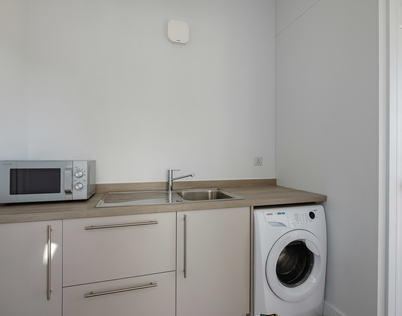The well-equipped utility room at Lowena self catering holiday home in Polzeath, North Cornwall.