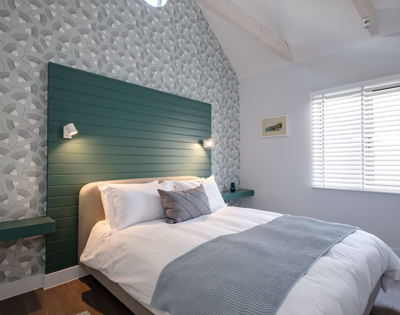 The king bedroom with shower room ensuite at Lowena self catering holiday home in Polzeath, North Cornwall.