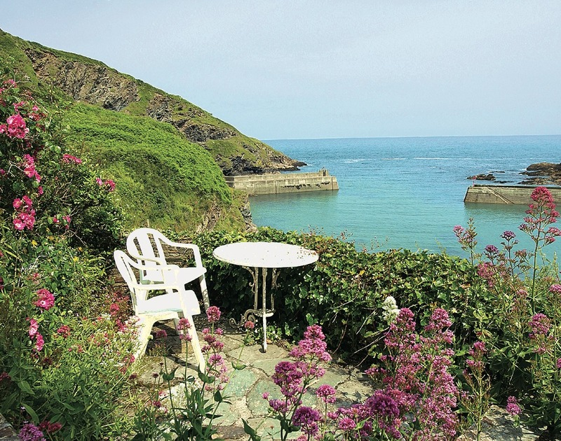 Panoramic sea  and harbour views from the patio of Northcliffe Garden Flat, a holiday rental in Port Isaac.