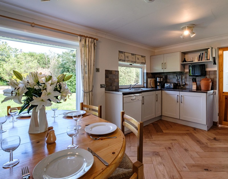 Open plan kitchen/dining room at Curlew, a self catering holiday rental near Porthilly Cove in Rock.
