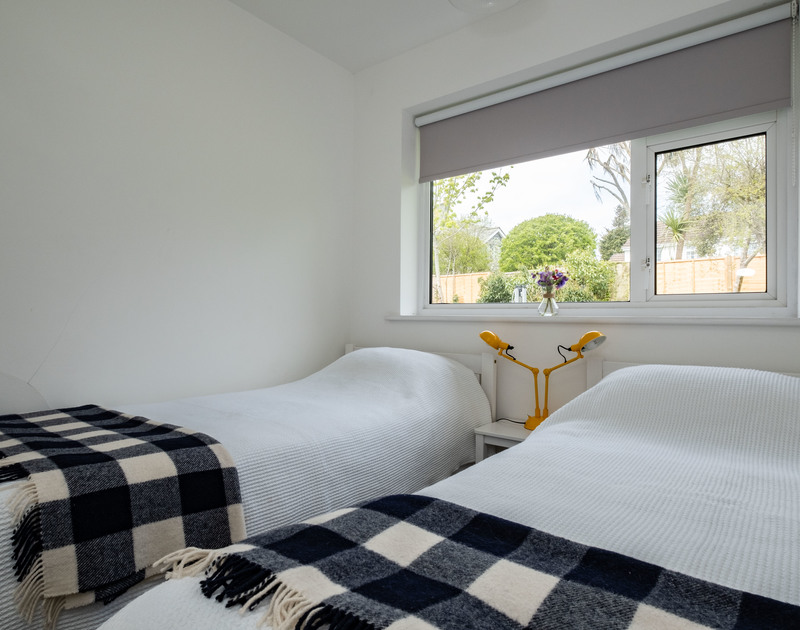 The twin bedroom in Corriana, a pet friendly, self catering holiday rental close to the shops and a ten minute walk from the beach at Rock in North Cornwall.
