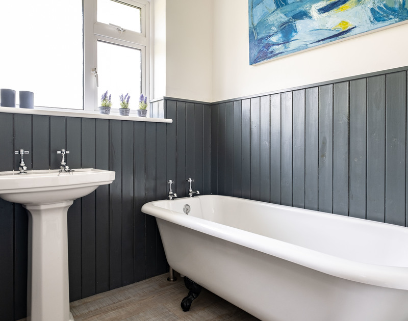 The tasteful and classic refurbished family bathroom in Corriana with a freestanding bath and separate shower, toilet and basin, self catering holiday accommodation in Rock, North Cornwall.