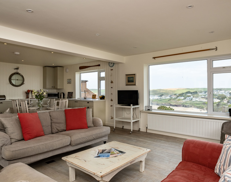 The colourful and comfortable lounge at Atlantis, a seaside holiday house to rent in Polzeath, North Cornwall.