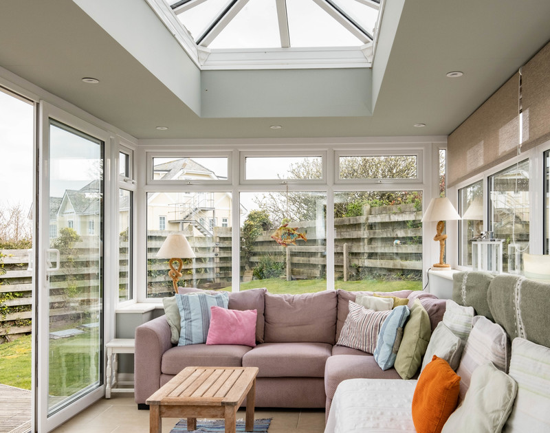 The bright, light-filled conservatory at Atlantis, a self catering holiday house to rent by the sea in Polzeath, North Cornwall.