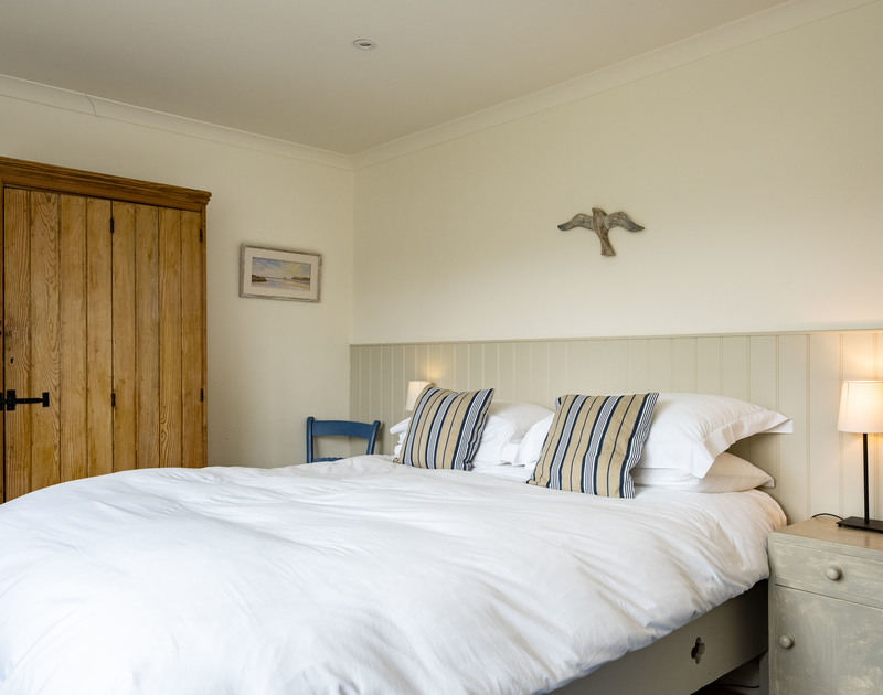 The well furnished king sized bedroom in Atlantis, a self catering holiday house to rent overlooking the sea at Polzeath in Cornwall.