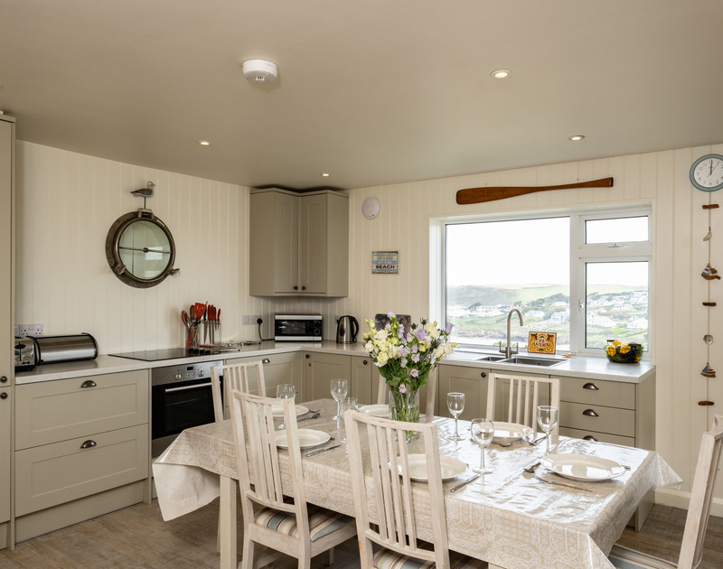 The tasteful and contemporary kitchen at Atlantis, a self catering holiday rental by the sea in Polzeath, North Cornwall.
