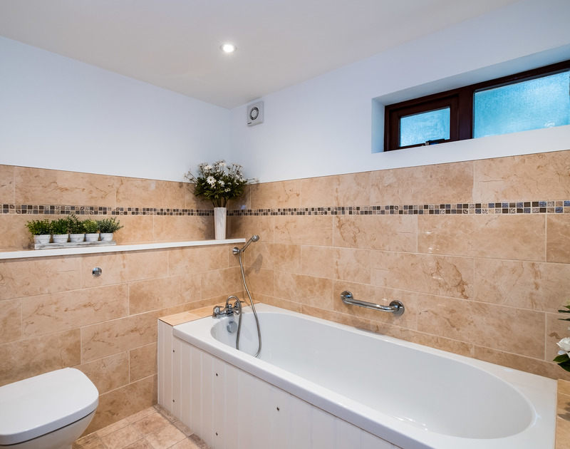 The family bathroom at self catering holiday property Little Trig, located next to St Enodoc Golf Course and overlooking the beautiful Camel Estuary in Cornwall.