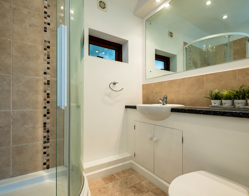 The shower room ensuite for the master bedroom at self catering holiday rental Little Trig which overlooks the beautiful Camel Estuary in Rock, North Cornwall.