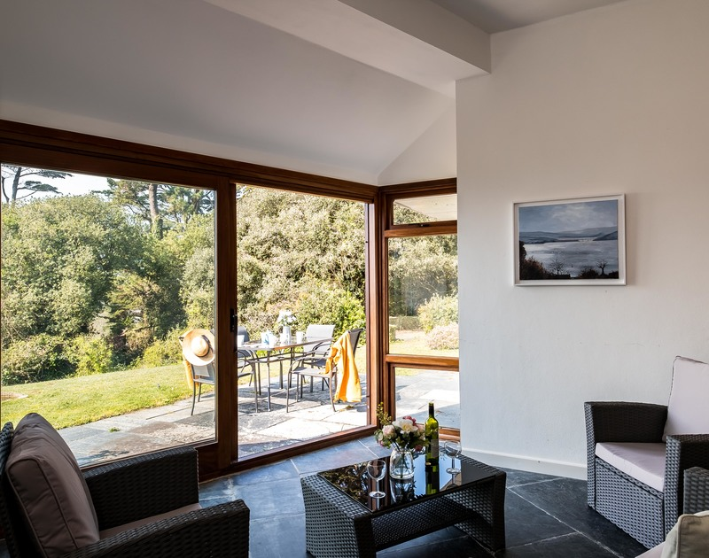 Indulge in a glass or two and relax in the garden room at Little Trig while enjoying the far reaching, unspoilt Camel Estuary views from this fabulously located holiday property in Rock, North Cornwall.