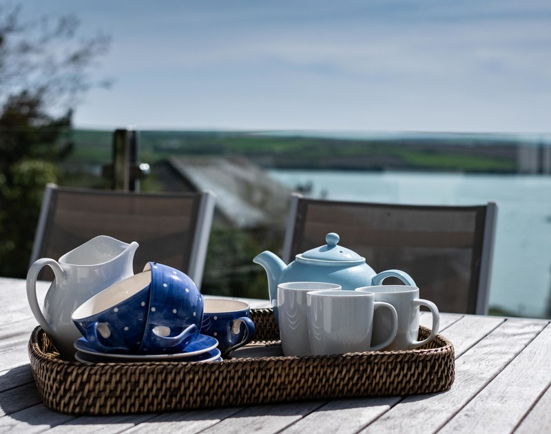 Enjoy amazing Estuary views while listening to the sounds of the coast on the decking at Landers, Rock.