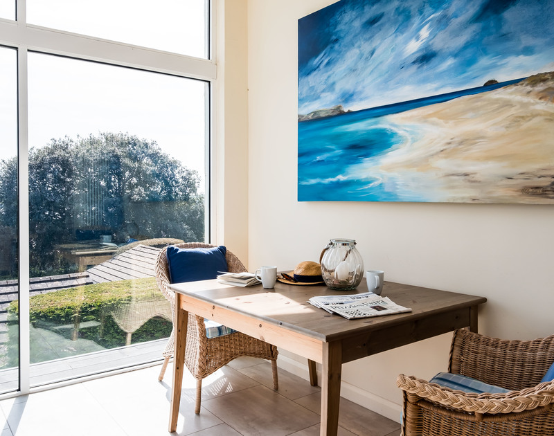 Gorgeous sea and countryside views from the conservatory at Landers, a superb holiday house in Rock, Cornwall