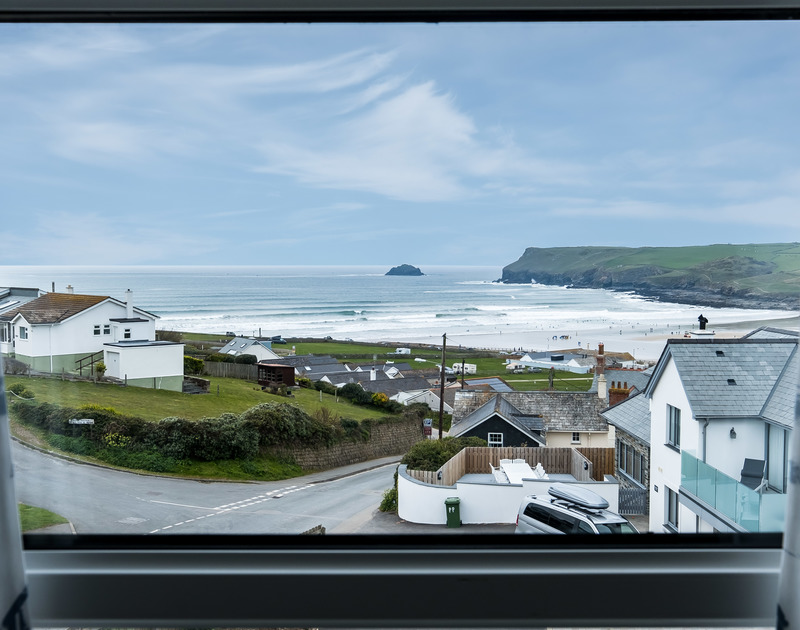 The amazing view of Polzeath beach from Pinewood 14 self catering holiday home in Polzeath, North Cornwall.