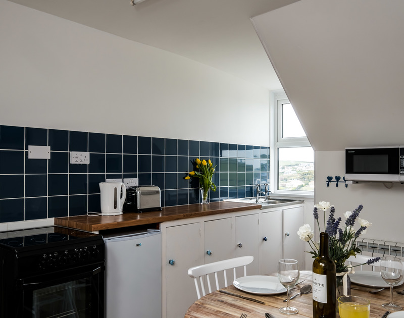 The well-equipped kitchen at Pinewood 14 self catering holiday home in Polzeath, North Cornwall.