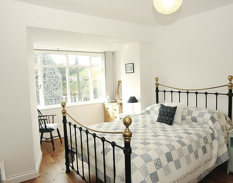 Spacious and light king sized bedroom in Stowaway, a self catering romantic retreat to rent in Port Isaac, Cornwall.