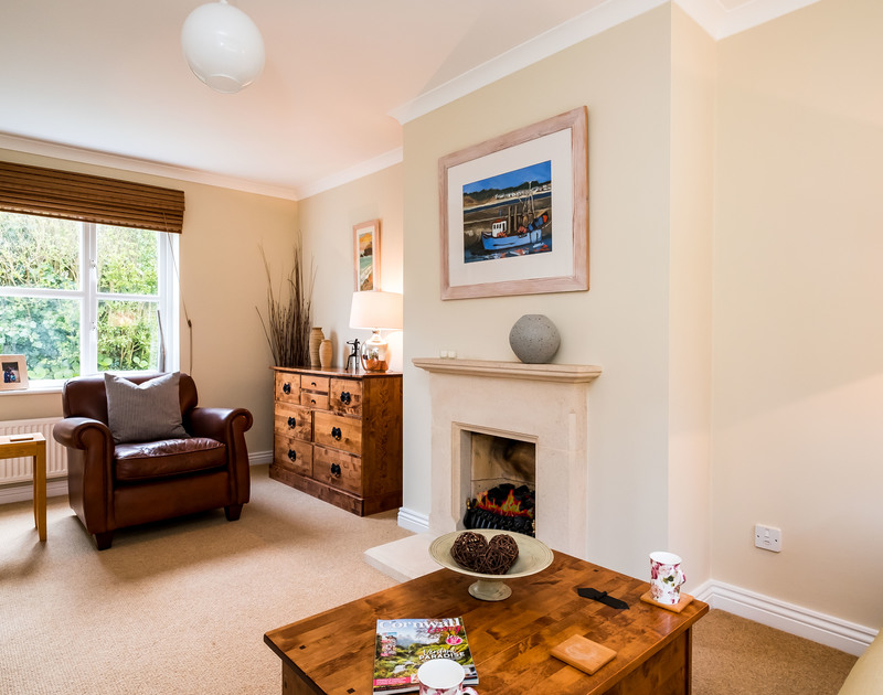 The welcoming living room at Brea, a self catering holiday rental in Tredrizzick, opens onto the garden and patio.