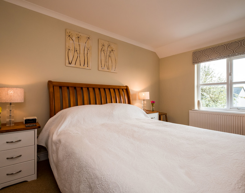 The spacious king size bedroom in Brea, a self catering holiday rental in Tredrizzick, Rock, Cornwall.
