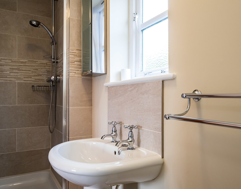 A handy ground floor shower and cloakroom is set off the utility room at Brea in Rock, Cornwall