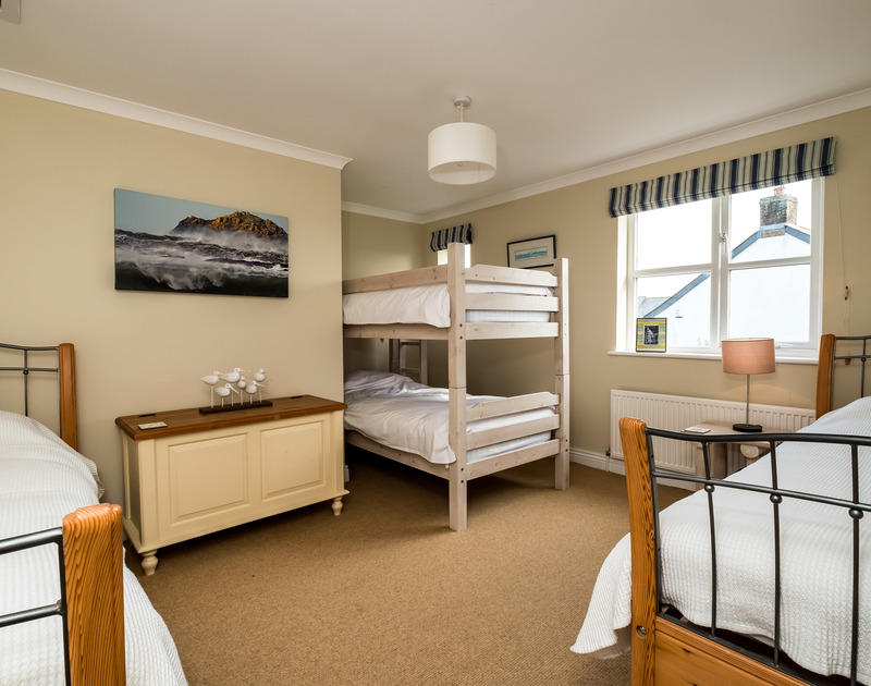 The family bedroom at Brea has bunk beds and two single beds and shares a family bathroom