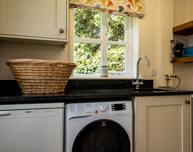 The handy utility room at Brea in Rock, North Cornwall has an attached ground floor cloakroom.