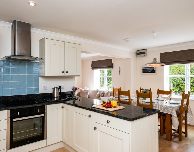 The contemporary kitchen at Brea, a self catering holiday house to rent in Tredrizzick, Rock, Cornwall.
