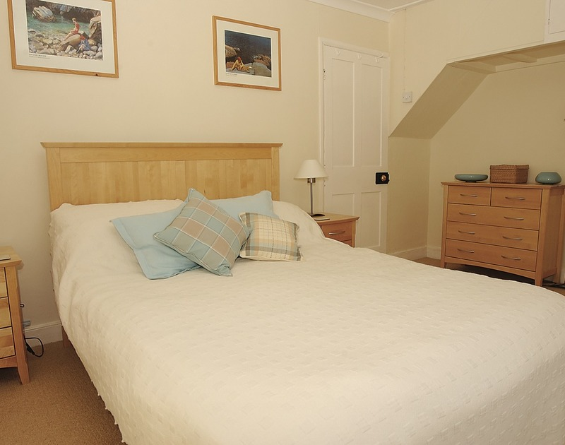 Double bedroom with sea views at Tremanon, a self catering holiday cottage to rent in Port Isaac, North Cornwall.